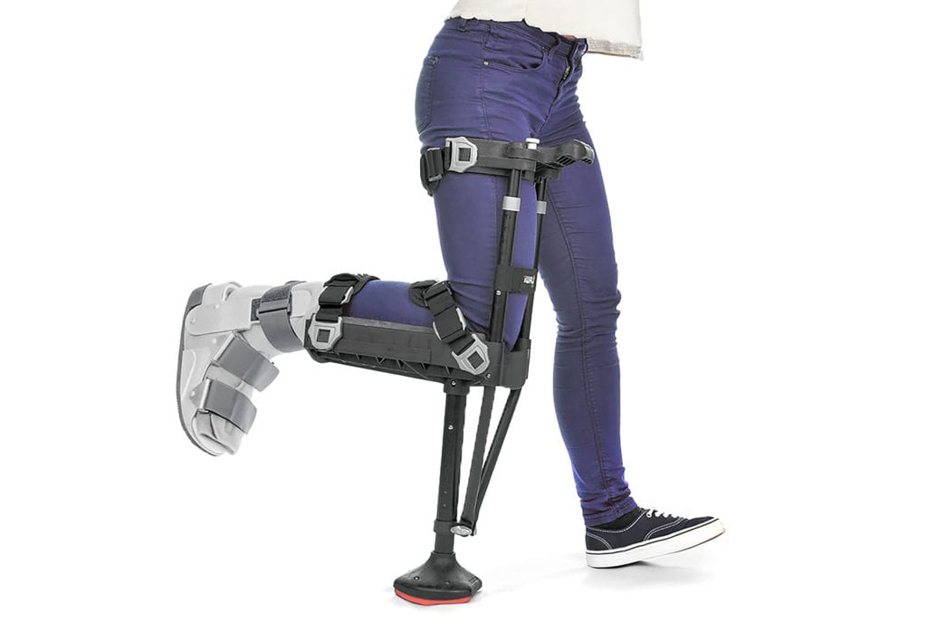 person with aircast boot walking with iwalk2.0 hands free crutch